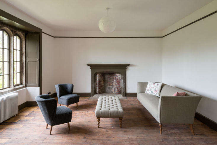 One of the two reception rooms on the first floor. Every wall in the home is painted white for a fresh and modern look.