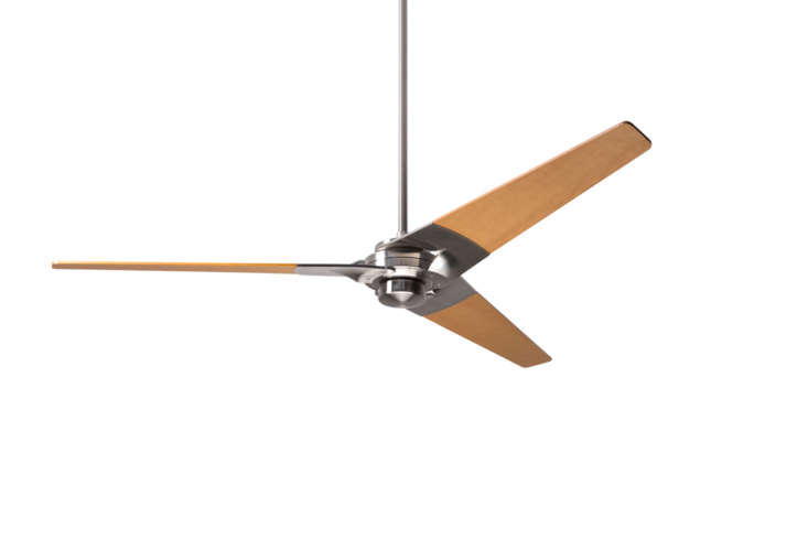 The Torsion Modern Ceiling Fan comes in Gloss White, Bright Nickel, or Dark Bronze with white, nickel, black, maple (shown), or mahogany blades. Prices start at $364 from Barn Light Electric Co.