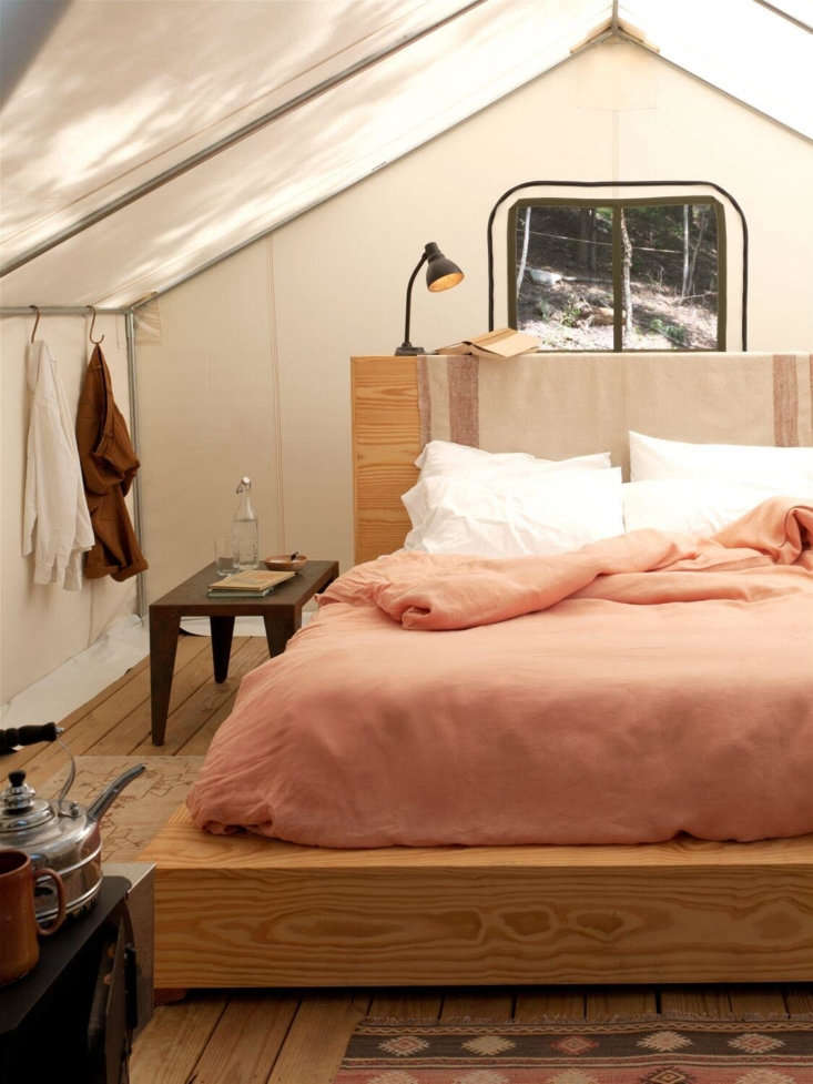 Jesse and the Aesthetic Movement team furnished the tents with custom pine platform beds (the high headboards double as shelving on the reverse side) and wood-burning stoves with kettles for making tea or filling hot water bottles. S hooks on the tent poles serve as clothes hooks. At check-in, guests are given a welcome kit that comes with palo santo incense, an annotated list of local attractions (from hikes and ponds to a cidery and auction house), plus instructions for keeping away bears.