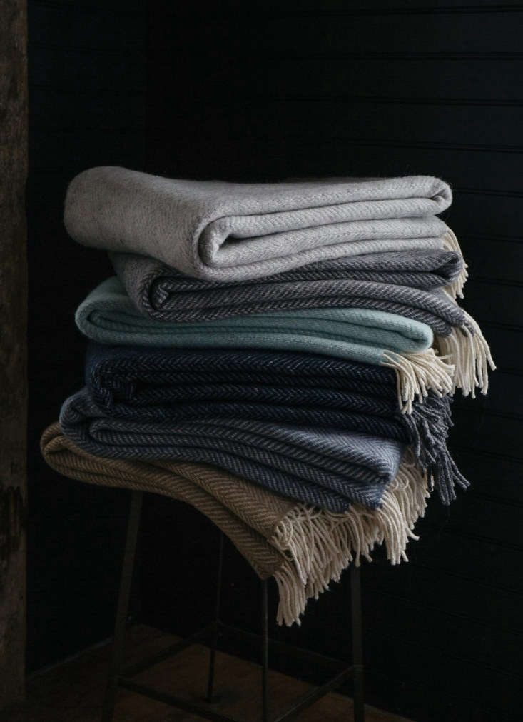 a stack ofherringbone throws (\$\264 each), available in colors such as fog a 9