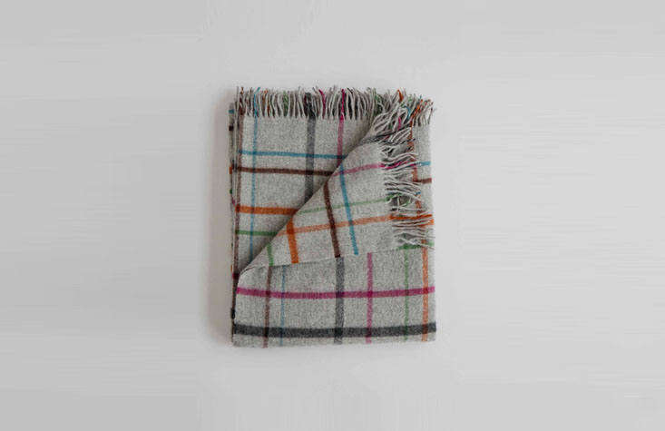 thepatterned merino throw (\$\24\2) offers a sense of nostalgia, with bright  12