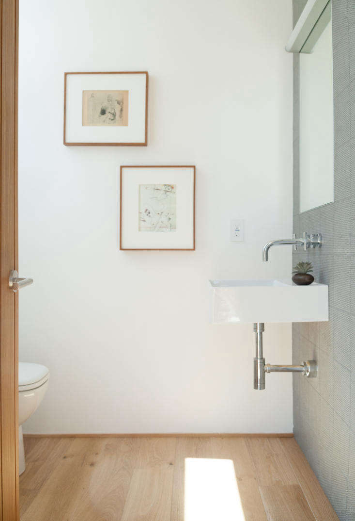 Let There Be Light Habitat 6 in Los Angeles Townhouses Designed for Brighter City Living One model of bath, with one wall clad in Azulej Tiles by Patricia Urquiola for Mutina. Even the toilets are luxe: Units are fitted with Toto Drake II commodes.
