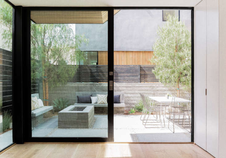 Let There Be Light Habitat 6 in Los Angeles Townhouses Designed for Brighter City Living Another patio, with poured in place concrete walls for privacy and a concrete fire pit.