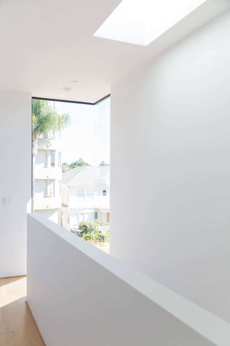 Let There Be Light Habitat 6 in Los Angeles Townhouses Designed for Brighter City Living In places like hallways and the tops of stairs, where privacy is less of a concern, full height glass panels bring in extra sun.