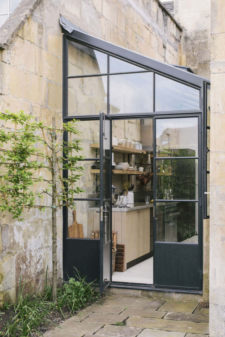 the greenhouse style extension is fitted between two wings of the house (scroll 9