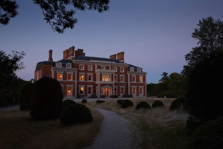 The freshly sand-blasted exterior of Heckfield Place at dusk.