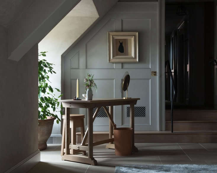 A desk and candle in one of the guest rooms.