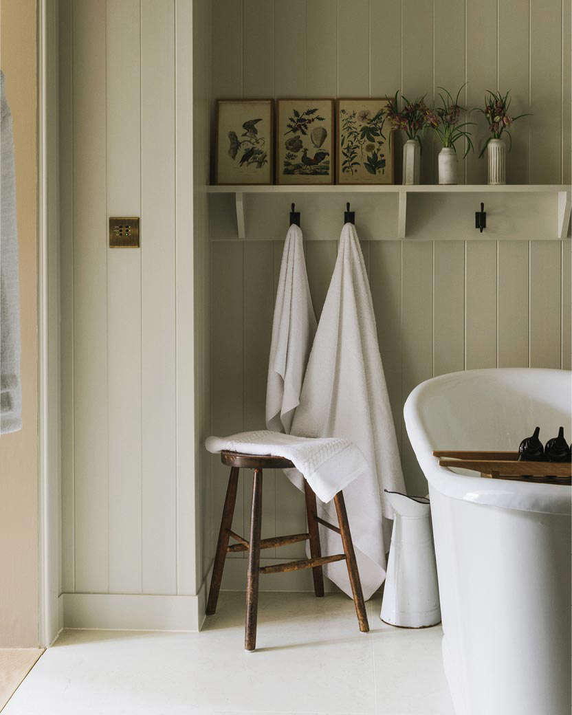 Botanical prints and hooks in the guest bath.
