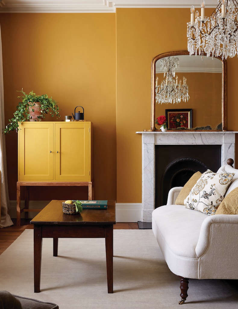 A fresh coat of ochre paint conjures an autumnal feel in this cozy living room at Heckfield Place. See: Heckfield Place: 'Hushed Luxury' in Hampshire, England.