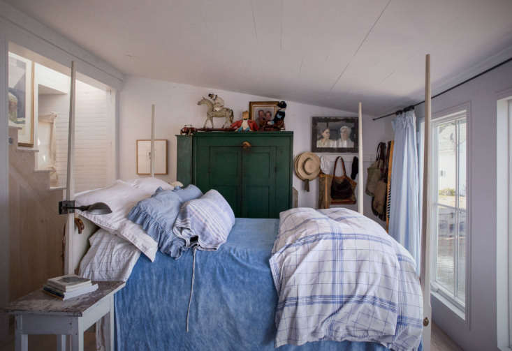 On a bed purchased from Leonards in Rhode Island, the couple paired Ralph Lauren bedding with a hand-dyed, linen, top-spread from France.