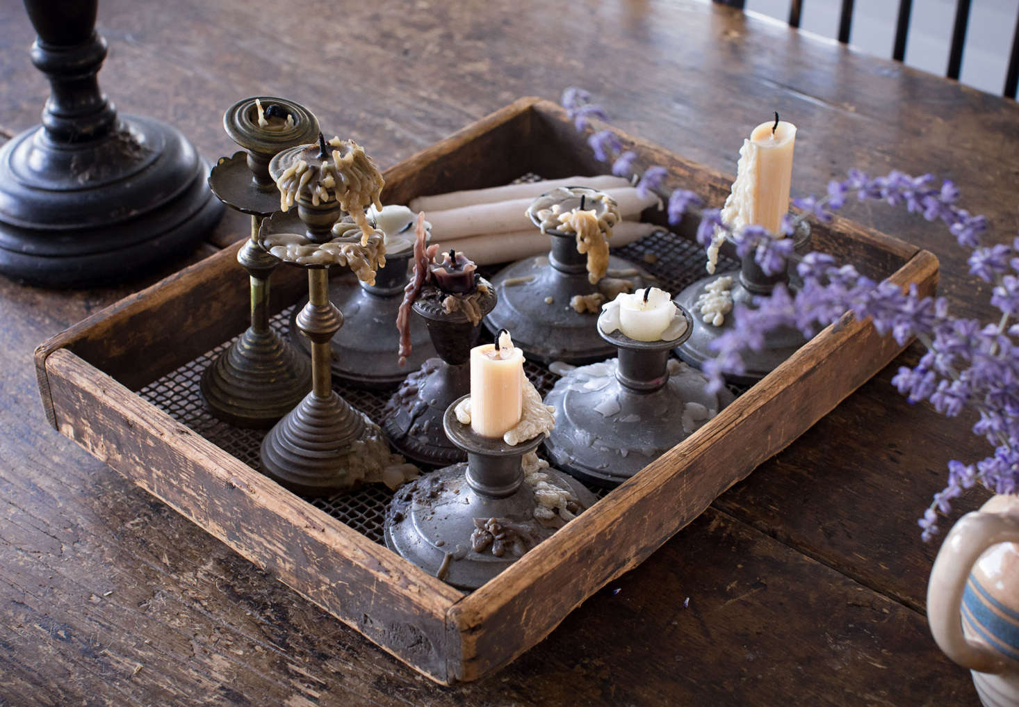 Sharon and Paul love burning beeswax candles in their collection of candlesticks, which includes American pewter as well as brass sticks that were a gift in the 70s from Sharon&#8