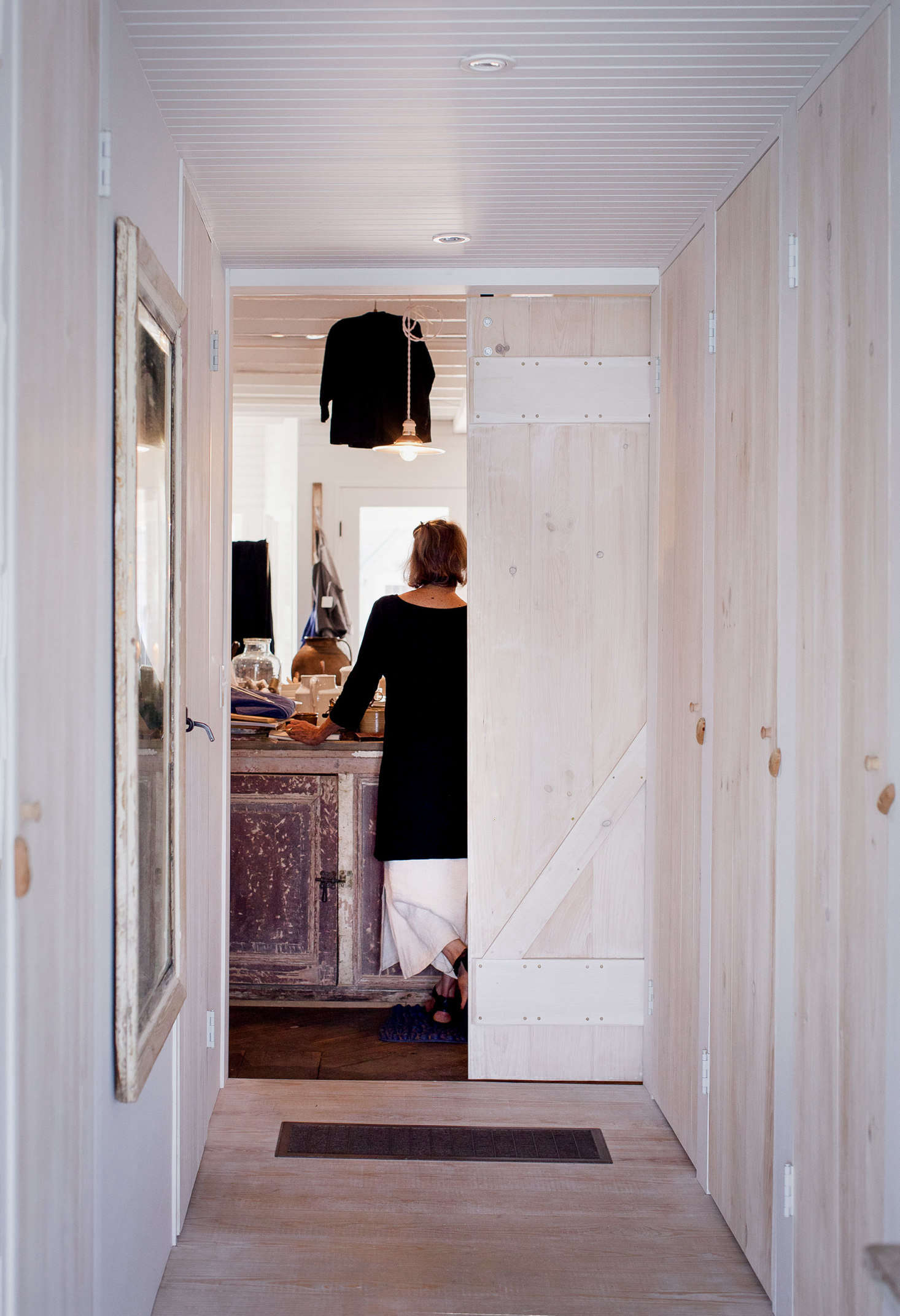 A hallway, flanked by the master bath and ample closets, leads from the back bedroom to the storefront.