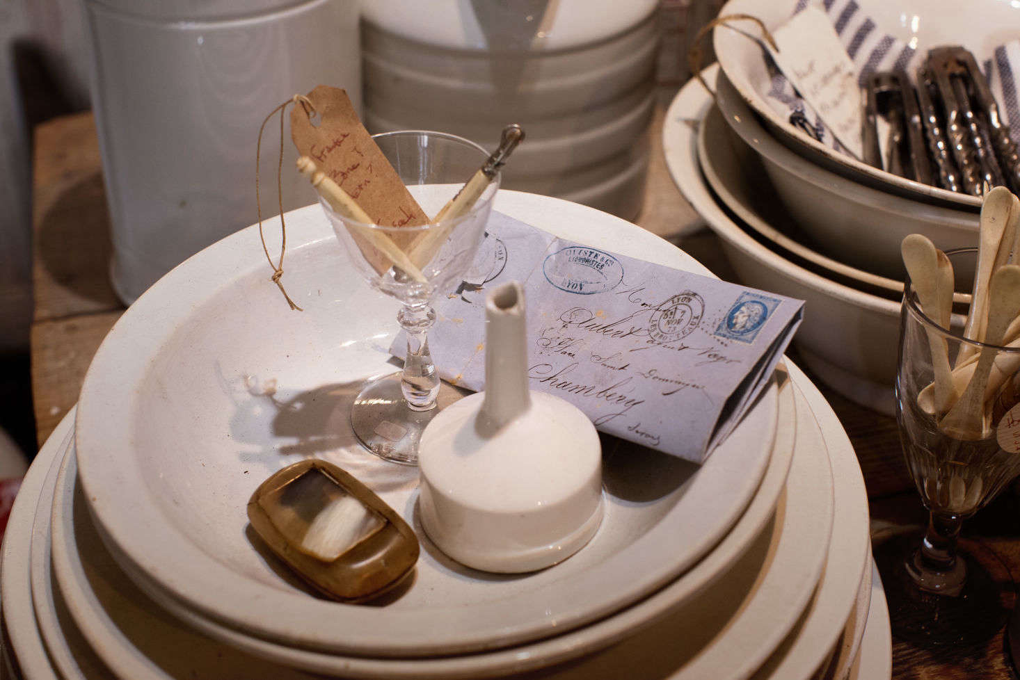 During their winters in France, Sharon and Paul scour flea markets for their fabulous finds, including textiles, silverware, baskets, ephemera, and tons of ironstone.
