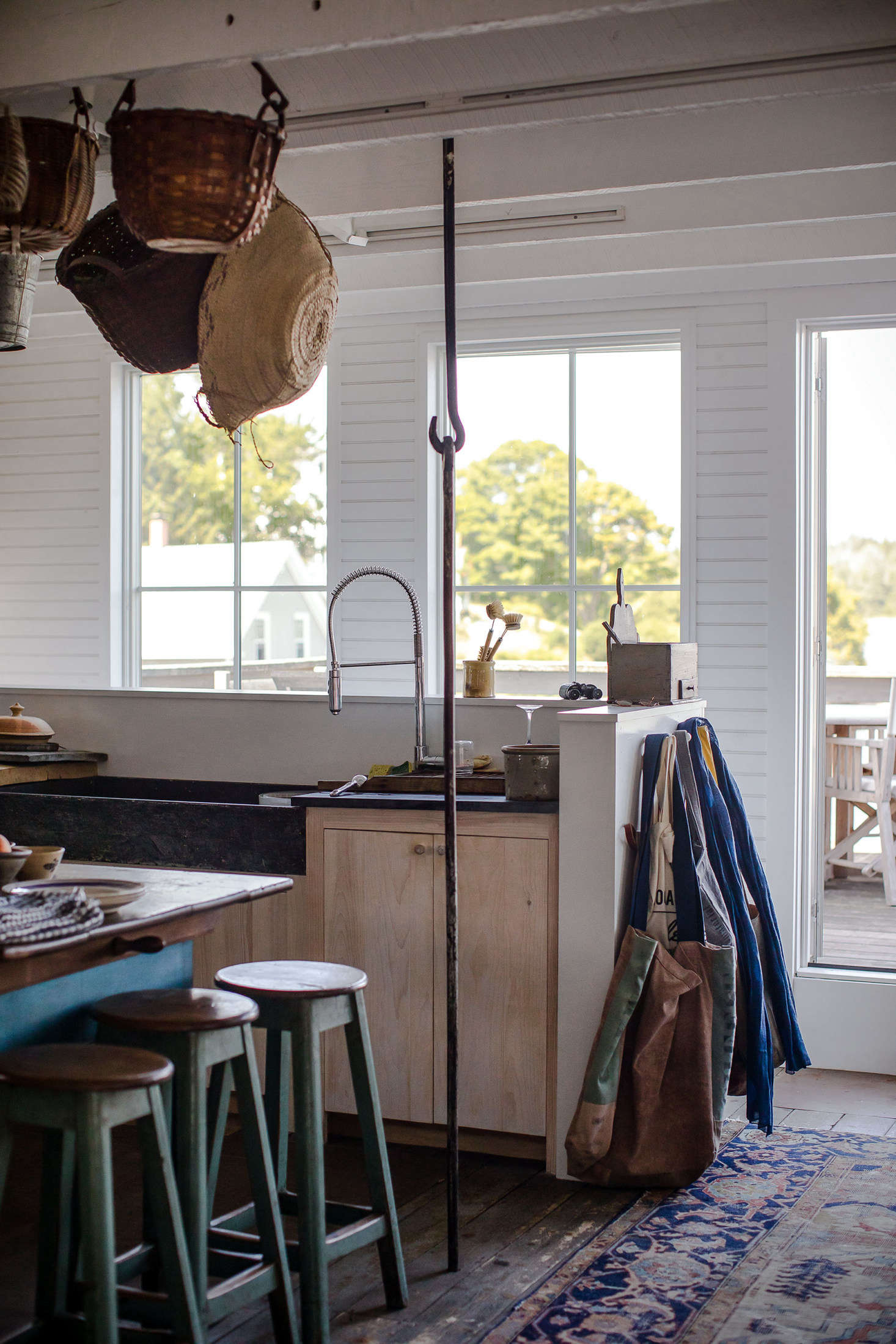 A wonderful historic detail: iron support hooks enhance the rustic feel.