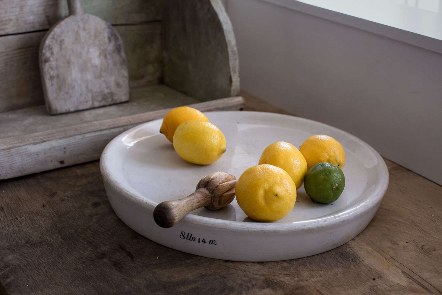 The couple repurposed an old English scale weight as a tray.