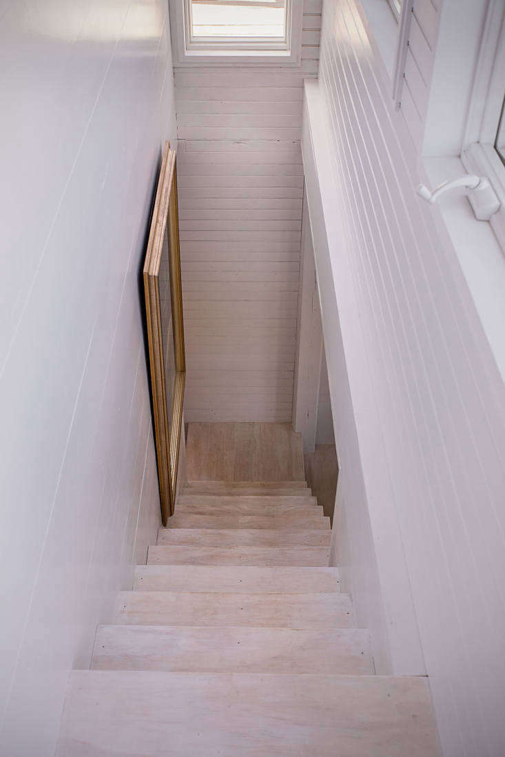 A stair leads along the back to the upstairs living area to the bedroom and shop below. Paul achieved a white-washed look in the floors with watered-down BIN.