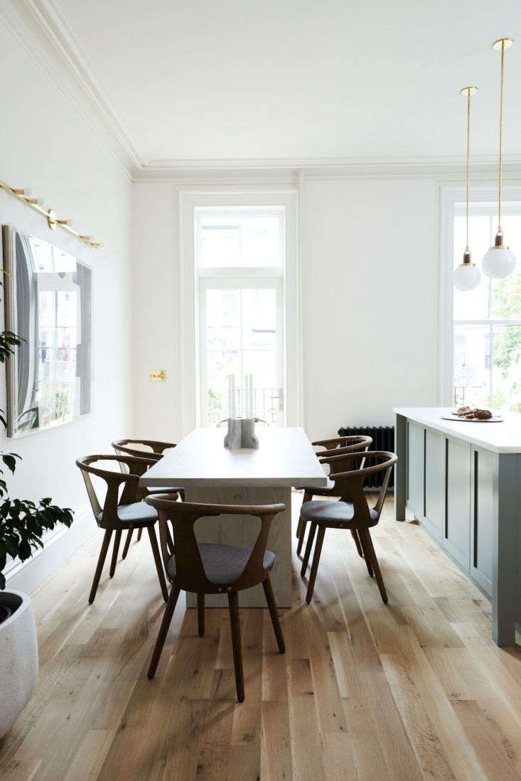 The dining room adjacent to the kitchen island. Photograph by Nicole Franzen fromRehab Diary: Monochromatic Luxe in Park Slope.