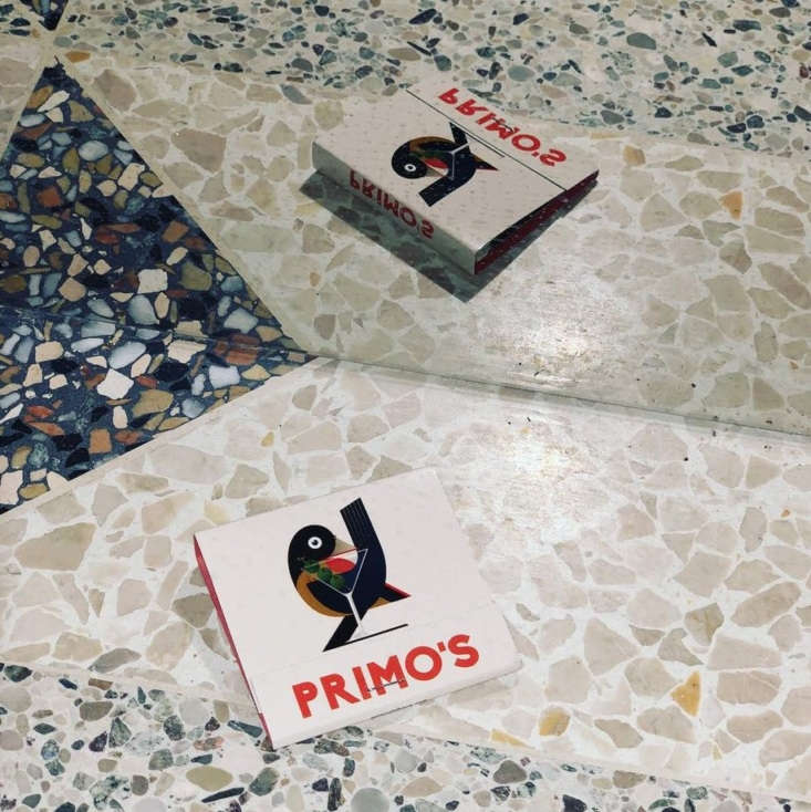 A classic matchbook photographed on the mismatched terrazzo tile floor.