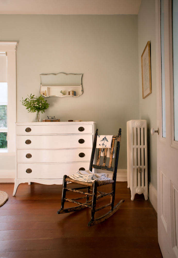 The rocking chair is a flea market find and the vintage dresser came with the house; Julie painted it white a few summers ago. On the rocking chair: a stack of Les Indiennes sample fabrics Julie picked up at Summerhouse in Mill Valley, California.