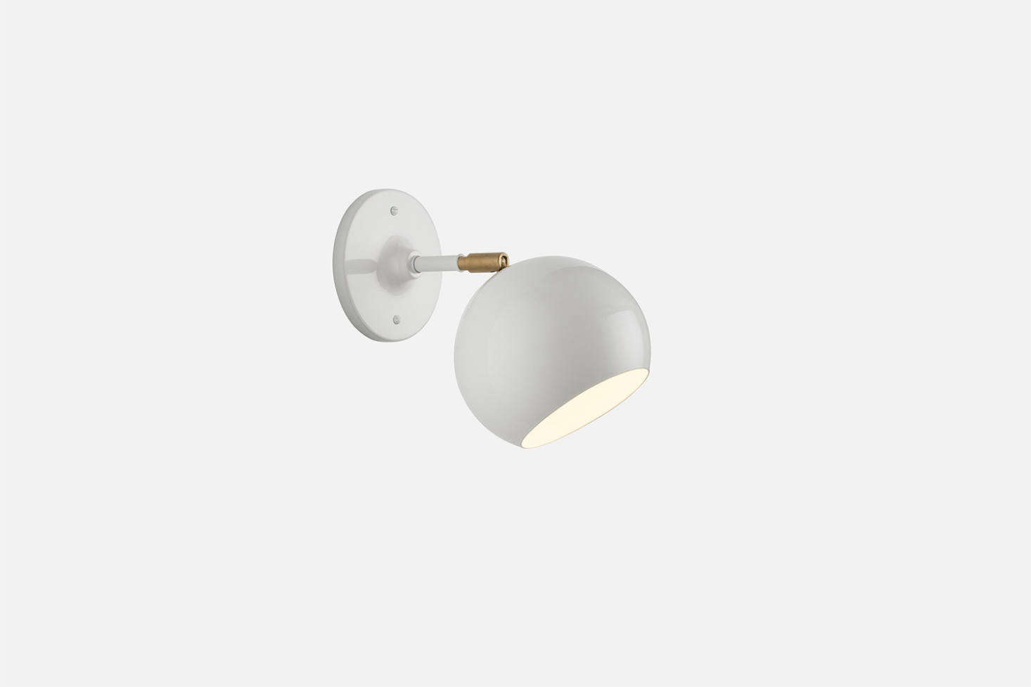 TheIsaac Sconce with a short arm is inspired by midcentury Scandinavian lighting and available in black, white, and Persimmon; $9 at Schoolhouse. It&#8