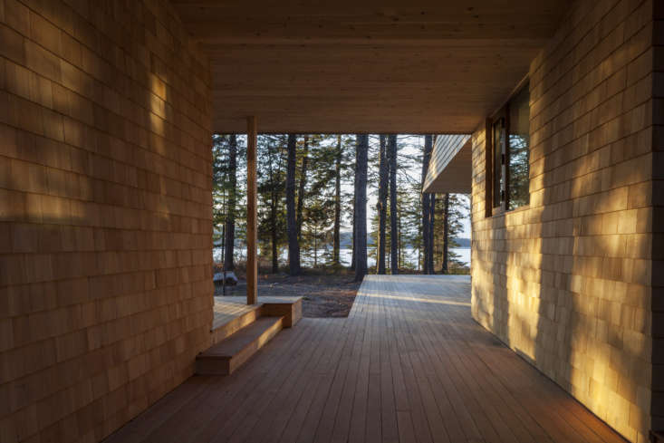 the breezeway leads out to the twin back porches overlooking somes sound. 15