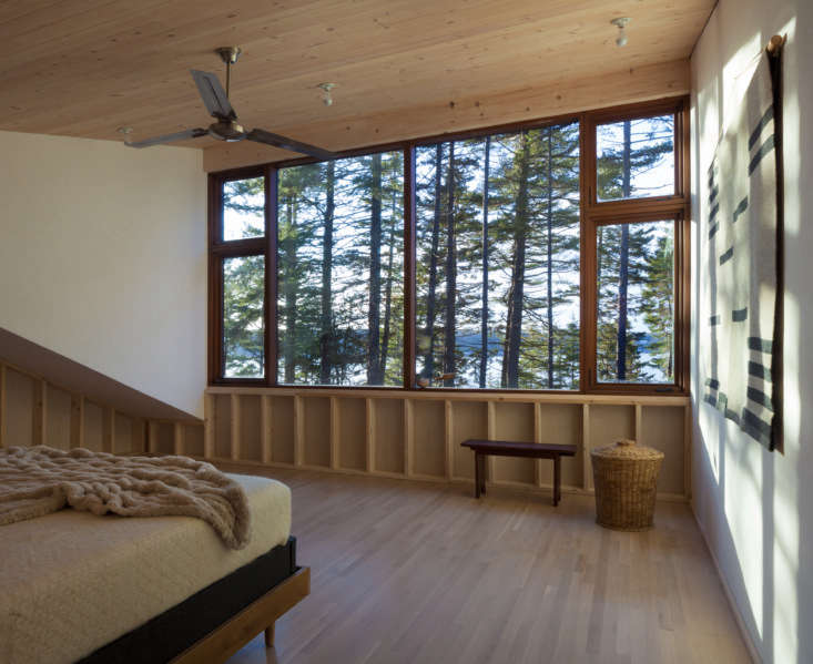 the simple master bedroom was designed to feel like a tree house. the wood floo 14