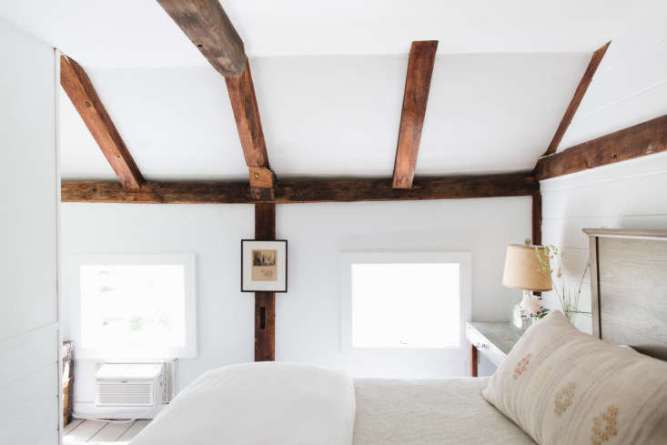 The Peruvian bed pillow in Bedroom Eight is from the Coastal Maine Antiques Showin Maine. The walls are paintedSherwin Williams Extra White.