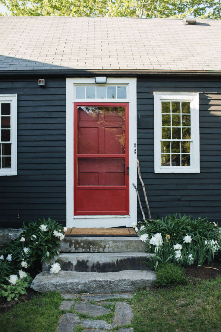 The exterior black is a custom color called Tarbox Black, which can be sourced through any Sherwin Williams dealer via the Sherwin Williams store in Damariscotta, Maine.The white trim shade is Sherwin Willaims Modern White and the red doors are Sherwin Williams Bolero.