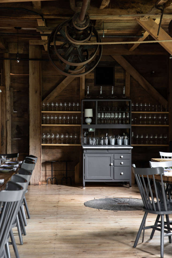 On one wall, a vintage hutch holds the restaurant&#8