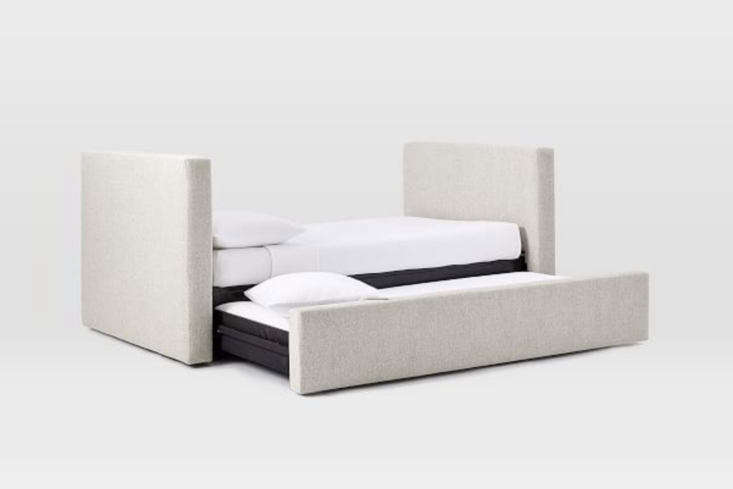 the west elm urban daybed with trundle is upholstered in stone colored fabric o 12
