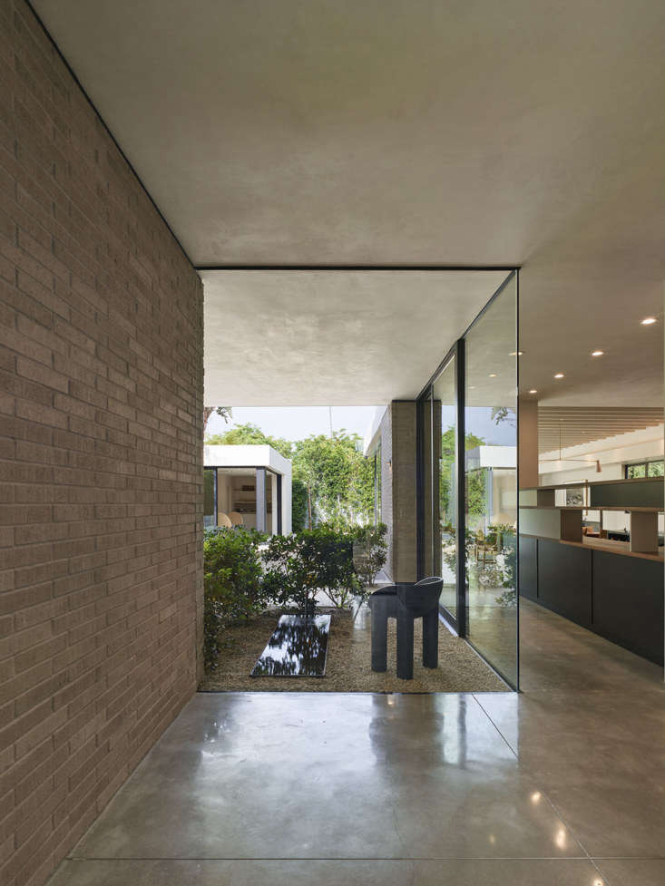 frameless floor t0 ceiling windows provide views through to the back of the hou 14