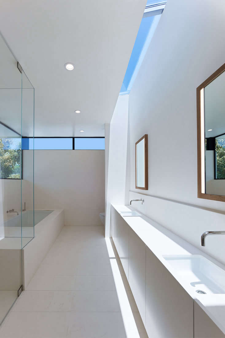 a skylight and clerestory windows light the master bath, which is almost entire 22
