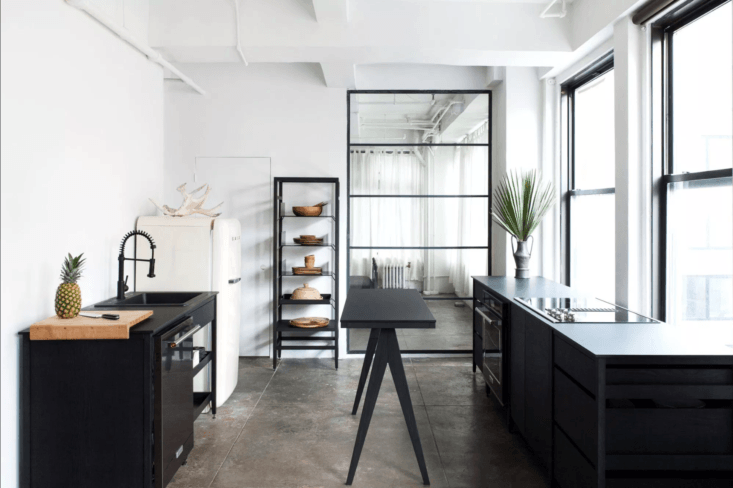 Black-hued Coquo furniture at the rentable Witness Apartment in New York; see more inKitchen of the Week: The Site of Your Next Dinner Party, in New York's Flower District.