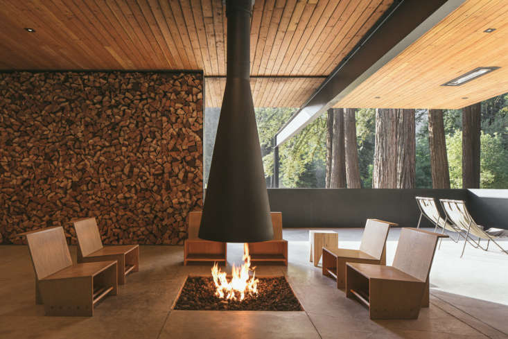 An indoor-outdoor firepit in the Clubhouse. The Clubhouse was designed to embody a midcentury-inspired style while being equipped to deal with the unpredictable and occasionally harsh weather conditions of the region.