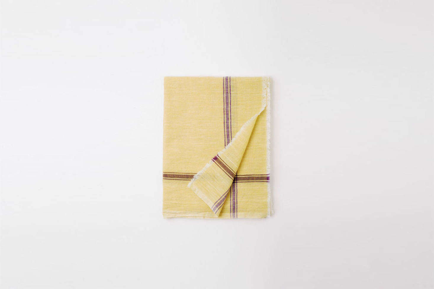 The towel hung next to the sink is an Auntie Oti Woven Towel. Different color combinations of patterned towels are available, starting at $36 each from Auntie Oti.