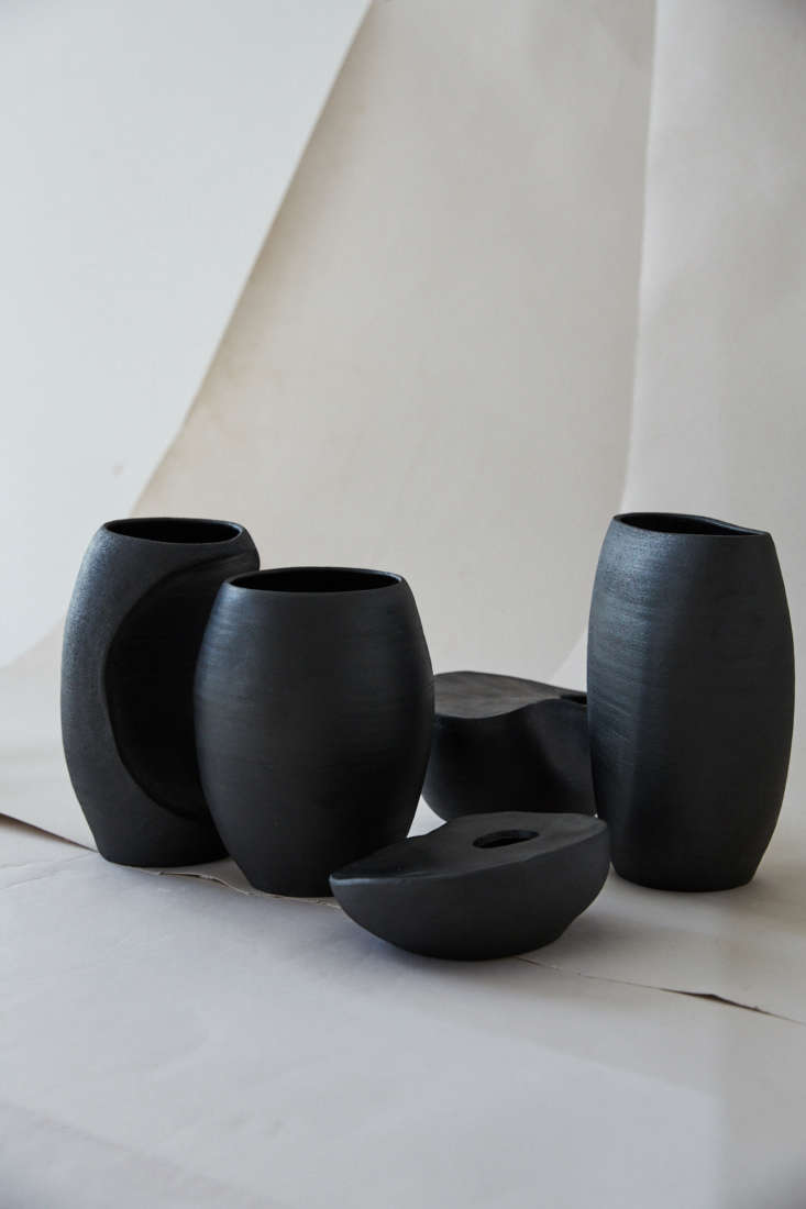 matte black stoneware pieces are thrown and then altered by hand to create unus 12