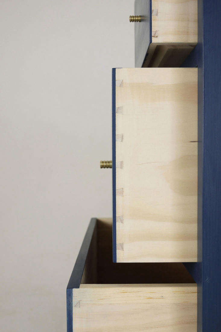 a detail of the hand cut joinery and brass pulls on thefin dresser. 20