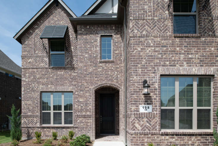 A Texas home sports dark brick in several bond patterns.Photograph courtesy of the Brick Industry Association.