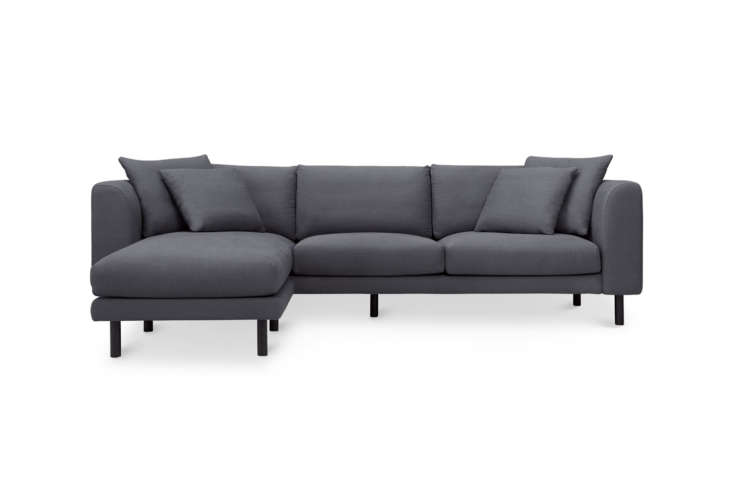 The budget-priced Capsule Verso Sectional Sofa comes in Charcoal Blue Linen (shown) or Light Grey Weave; on sale now for $loading=