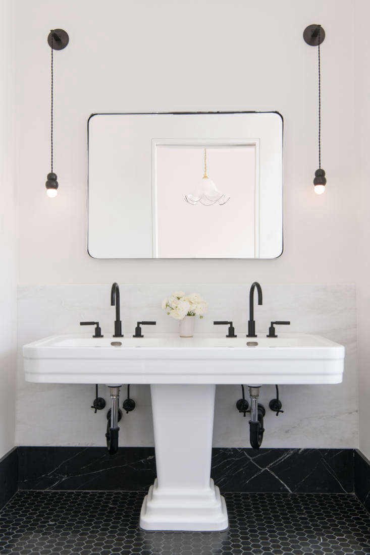 Black-and-white master bath with a double sink in a Brooklyn townhouse remodel by Elizabeth Roberts Architecture and Design. Photograph by Dustin Aksland.