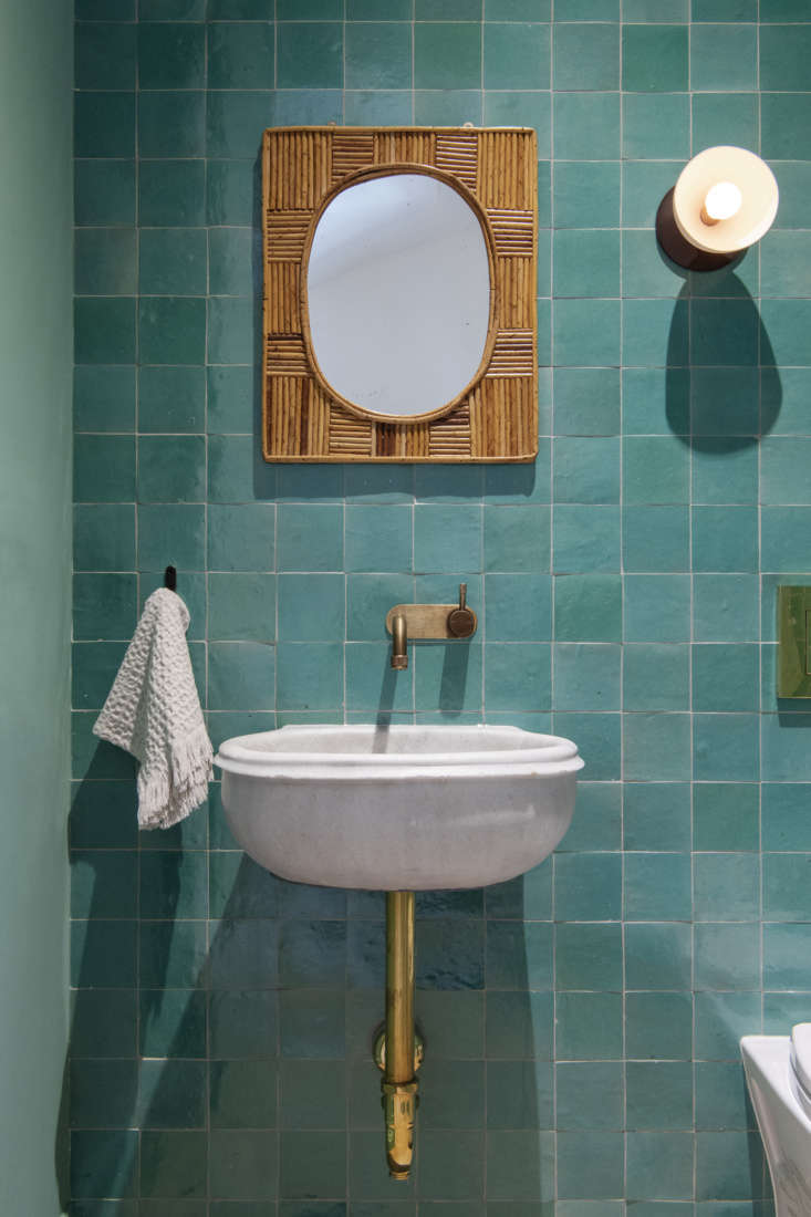 Inspired by Emery et Cie's Moroccan tiles, architect Elizabeth Roberts sourced the powder room'sZellijfrom Mosaic House in New York. Photograph byDustin Askland, courtesy of Elizabeth Roberts Architecture & Design, from Serial Remodelers Settle Down: A Brooklyn Townhouse Reinvention from Elizabeth Roberts.