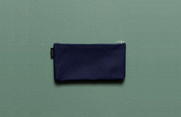 Remember those plastic pencil boxes that inevitably exploded their contents all over the floor if dropped? Stick to a durable (and washable) cloth zip pouch instead, like this Canvas Flat Pencil Case from Everyday Needs; $ NZD.