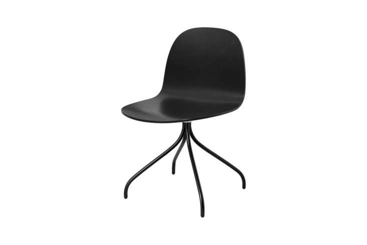 the gubi \2d chair has a swivel base and is made in wood (shown in black stain  18