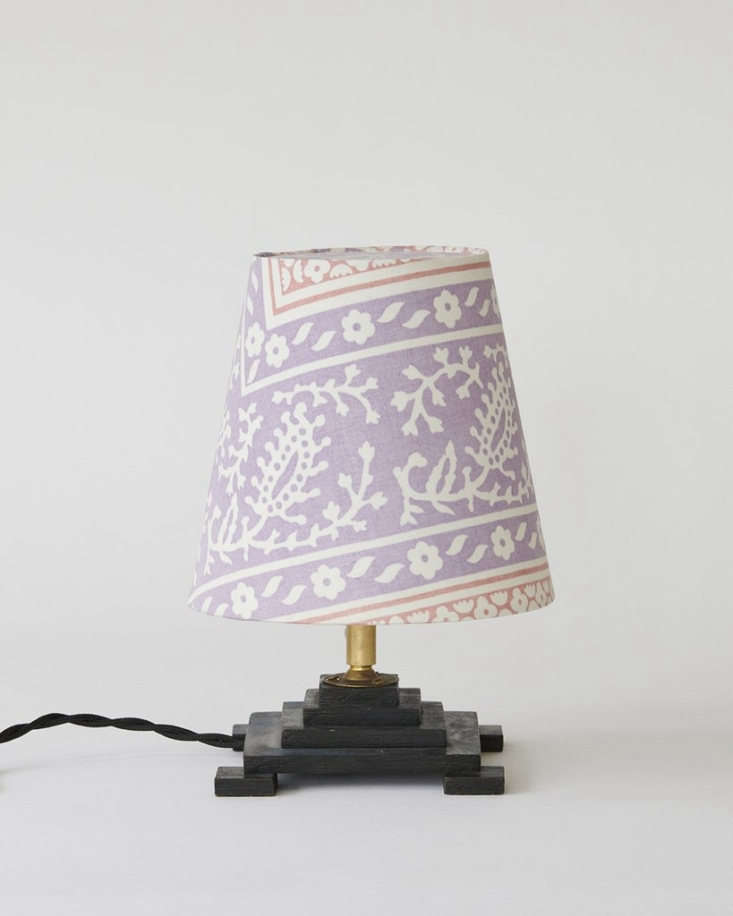 Copenhagen antiques dealer Helle Thygesen got her start working at the Apartment DK (see above), and she, too, offers an array of sculptural vintage lamps paired with patterned shades. This Dutch wood Modernist Table Lamp comes with a shade made of vintage Liberty fabric; $504.04. Customized Lamp Shades are also available à la carte.