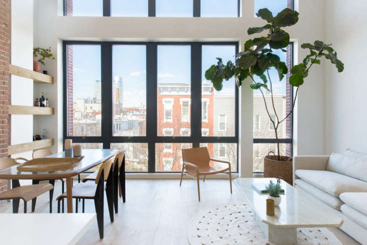 In the penthouse of a new condo development in Williamsburg, Brooklyn, Hollister and Porter furnished an airy living-dining room with Prouvé-look-alike Standard Chairs, $9, from France & Son; OX Denmarq&#8