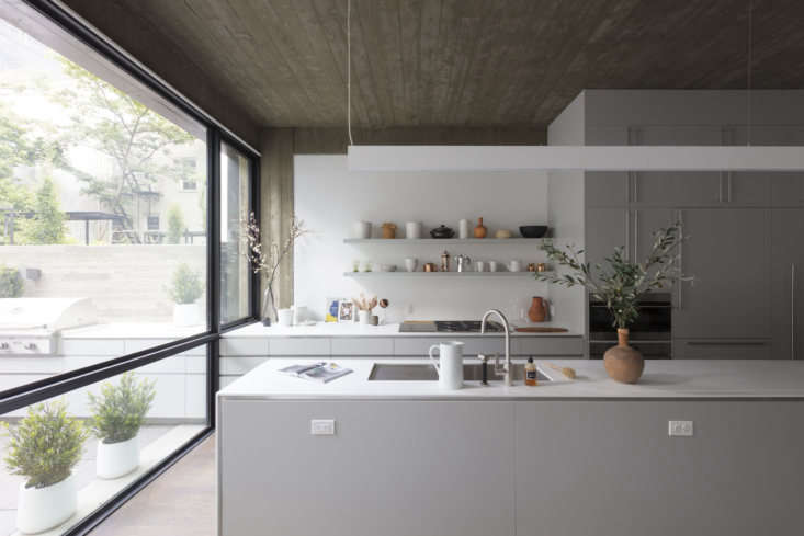 A kitchen styled with ceramics at Wythe Lane, a collection of six new single-family townhouses in Williamsburg developed by KUB and designed by the firm&#8