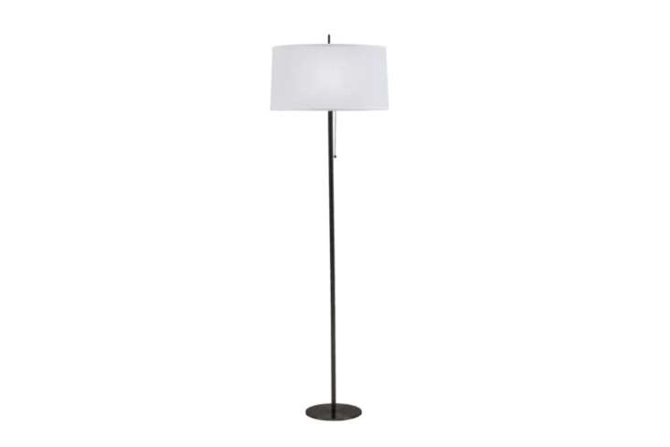 The on-budget Langley Street Cary Floor Lamp, with a black metal base and white linen shade, is $7.99 through All Modern.