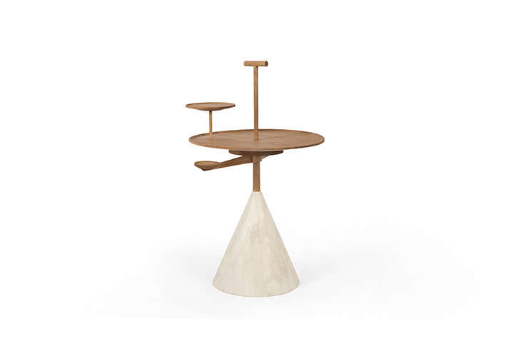 TheOrbit Table (from $5,0) has swiveling, movable pieces.