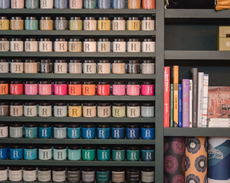 tester sized jars of paint lined up in the new york city showroom. ressource of 9