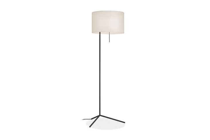 The Room & Board Crane Floor Lamp has a hand-welded base, a fabric cord, and a white fabric shade; $5.
